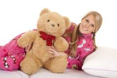 Woman pink pajamas bear lay on side smile Stock Image