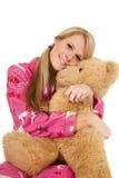 Woman pink pajamas bear sit hug Stock Images