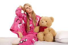 Woman pink pajamas bear sit look side Royalty Free Stock Image