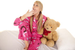 Woman pink pajamas bear sit yawn Royalty Free Stock Images