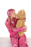 Woman pink pajamas kiss stuffed animal bear Stock Photos