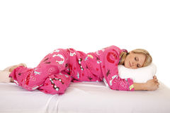 Woman pink pajamas lay side asleep Royalty Free Stock Photos