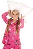 Woman pink pajamas pillow behind her head Stock Photos