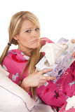 Woman pink pajamas tissue hold box frown Stock Images