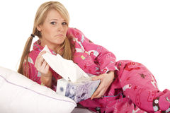 Woman pink pajamas tissue pull frown Stock Photos