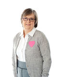 Woman with pink paper heart on her jacket Royalty Free Stock Photo