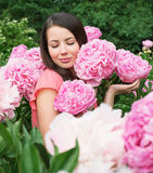 Woman with pink peonies Royalty Free Stock Image