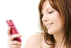 Woman with pink phone Royalty Free Stock Images