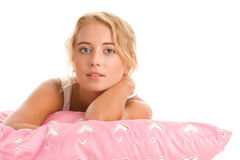 Woman with pink pillow Stock Photography
