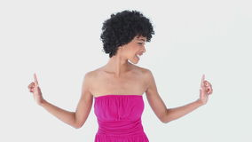 Woman in pink pointing up Royalty Free Stock Image