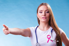 Woman pink ribbon on chest making welcome gesture Stock Photo