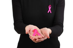 Woman with pink ribbon in hands Stock Photos