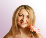 Woman  with pink rose Stock Photography