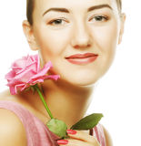 Woman with pink rose royalty free stock photography
