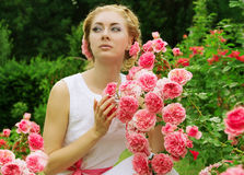 Woman in pink rose garden walking Royalty Free Stock Photography