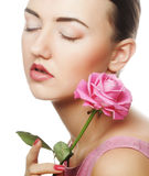 Woman with pink rose Stock Image