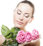Woman with pink roses. Isolated on white Stock Images