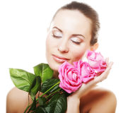 Woman with pink roses. Over white background Royalty Free Stock Photo