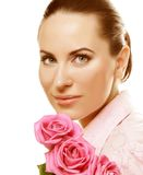 Woman with pink roses. Young Woman with pink roses Royalty Free Stock Photography