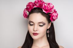 Woman pink roses. Closeup portrait of beautiful girl woman lady with volume combed hair styling. Luxury Bright makeup shiny lipstick cosmetics. New Professional Royalty Free Stock Photo