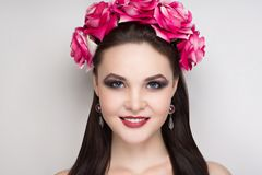 Woman pink roses. Closeup portrait of beautiful girl woman lady with volume combed hair styling. Luxury Bright makeup shiny lipstick cosmetics. New Professional Royalty Free Stock Image