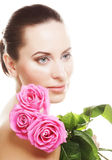 Woman with pink roses. This image has attached release Stock Photography