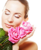 Woman with pink roses. This image has attached release Royalty Free Stock Images