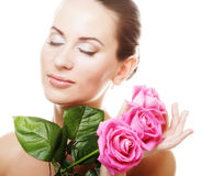 Woman with pink roses Royalty Free Stock Photography