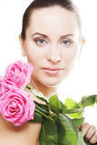 Woman with pink roses. This image has attached release Stock Photo