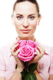 Woman with pink roses. This image has attached release Stock Images