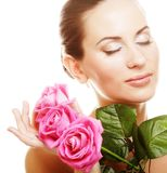 Woman with pink roses. Isolted on white Stock Photo