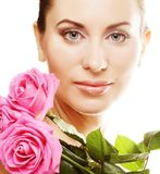 Woman with pink roses. Isolted on white Royalty Free Stock Images