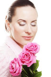 Woman with pink roses. Over white background Stock Photos