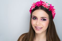 Woman pink roses wreath. Closeup portrait of beautiful girl woman lady with volume combed hair styling. Luxury Bright makeup shiny lipstick cosmetics. New Royalty Free Stock Images