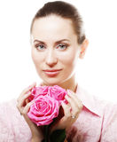 Woman with pink roses. Young Woman with pink roses Royalty Free Stock Photo