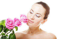 Woman with pink roses. Young Woman with pink roses Stock Photo