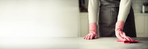 Woman in pink rubber protective gloves wiping dust and dirty. Cleaning concept, banner, copy space.  Stock Photos
