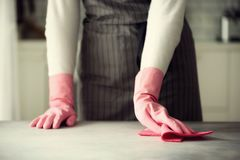 Woman in pink rubber protective gloves wiping dust and dirty. Cleaning concept, banner, copy space.  Stock Photo