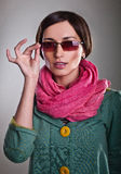 Woman in pink scarf with glasses Royalty Free Stock Photos