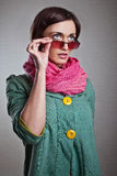 Woman in pink scarf with glasses Stock Image
