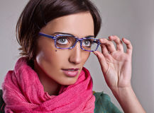 Woman in pink scarf with glasses Royalty Free Stock Images