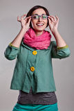 Woman in pink scarf with glasses Stock Images