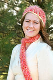 Woman in Pink Scarf and Hat Stock Photography