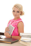 Woman in pink shirt books look side Royalty Free Stock Photo