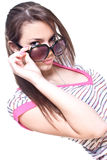 Woman in a pink shirt with the glasses Royalty Free Stock Photos