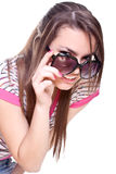 Woman in a pink shirt with the glasses Royalty Free Stock Photography