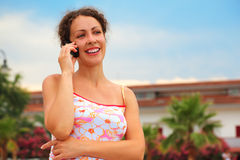 Woman in pink shirt talking on cell phone Stock Photography