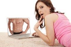 Woman pink shocked laptop Royalty Free Stock Images