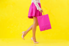 Woman with pink shopping bag Stock Photography
