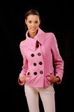Woman in pink short coat and white pants Royalty Free Stock Photos